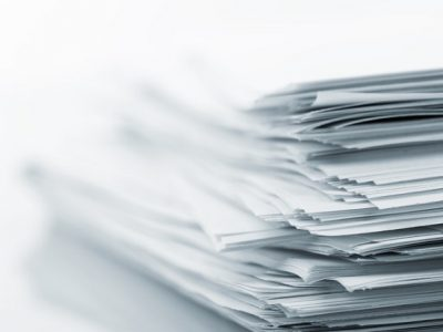 Stack of white papers isolated on white